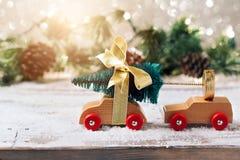Christmas tree on toy car over festive background. Christmas holiday celebration. Concept Stock Photo