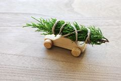 Christmas tree on toy car. Christmas tree on wooden toy car royalty free stock photography