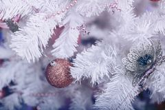 Christmas tree with a toy. Close-up Stock Photography