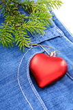 Christmas tree and toy on denim background. Stock Images