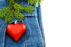 Christmas tree and toy on denim background. Stock Photo