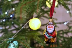 Christmas tree toy fisherman, grandfather with fish on a red ribbon hanging on a Christmas tree. royalty free stock photos