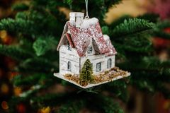 Christmas tree decoration toy in the form of cute little house Stock Photos