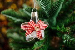 Christmas tree decoration toy in the form of glass star Stock Photo