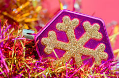 Christmas-tree toy on a pink background. Close up Stock Photos