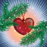 Christmas tree with toy The Red Heart. Two branches and The Red Heart is between them with sparkles around Stock Photography