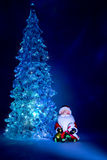 Christmas tree toy shining with a beautiful shadow Northern Lights background and highlights in the form on a dark blue background Royalty Free Stock Images