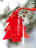 Christmas tree toy in snow with icicle Stock Images