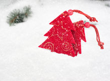 Christmas tree toy in snowfall Royalty Free Stock Photo