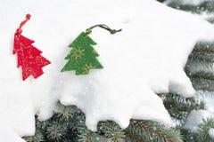 Christmas tree toy in snowfall Stock Photos