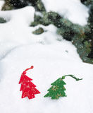 Christmas tree toy in snowfall Royalty Free Stock Photography