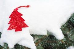 Christmas tree toy in snowfall Royalty Free Stock Photos