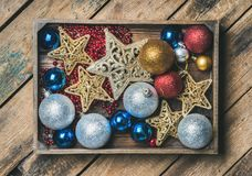 Christmas tree toy stars, balls and garland in wooden box Royalty Free Stock Images
