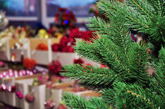 Christmas tree in a toy store. Christmas tree in the background of boxes with ornaments in a toy store Stock Photos