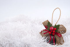 Christmas-tree toy on a white background tinsel. Stock Photos