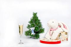 Christmas Tree and a toy white rabbit Royalty Free Stock Photos