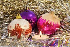 Christmas tree toys. Few round christmas tree toys, a candle and some decorations Royalty Free Stock Images