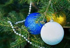 Christmas tree, Christmas toys, ball, beads. Shiny white, gold balls and silver beads on a Christmas tree closeup Stock Images