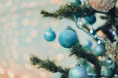 Christmas tree with toys in blue and golden. Decorated white room with christmas tree and blue toys royalty free stock photography