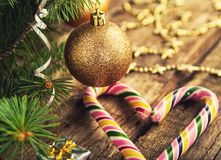 Christmas tree with toys, caramel cane and stars on dark wooden background in vintage style. stock photo