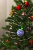 Christmas tree with toys. Closeup Royalty Free Stock Image