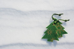Christmas tree toys covered with snow Royalty Free Stock Photos