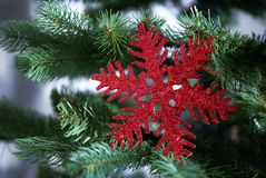 Christmas tree toys and decorations. Red snowflake.