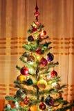 Christmas tree with Christmas toys. Christmas tree lights stock photography