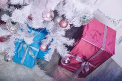 Christmas tree with toys and gift boxes close-up. Christmas tree with toys and gift boxes Stock Image