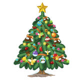 Christmas tree with toys and gold star on top Stock Images