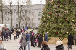 Christmas tree with toys and people in street royalty free stock photography