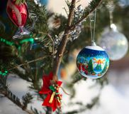 Christmas decorations on pine Royalty Free Stock Image