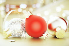 Christmas tree toys - red and gold balls and stars. Close up Royalty Free Stock Photos