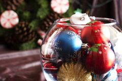 Christmas tree toys in a round glass vase Stock Photo