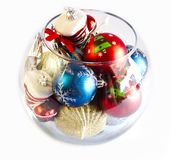 Christmas tree toys in a round glass vase. Christmas tree toys in the round glass vase royalty free stock photography