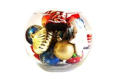 Christmas tree toys in a round glass vase. Christmas tree toys in the round glass vase stock images