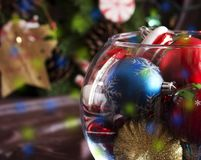 Christmas tree toys in a round glass vase Stock Image