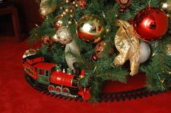Christmas tree and train Stock Photos