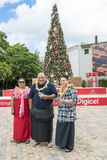 Local People of Tonga with Christmas Tree. Christmas time in Tonga, Pacific Ocean. People with traditional cloth are very proud of the tall christmas tree royalty free stock photography
