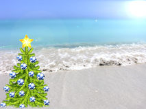 Christmas tree on a tropical beach premise. Christmas tree decorated with New Year's toys on a beach background Stock Photo