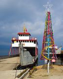 Christmas Tree in Tropical Indonesia. In the village of Parapat, at the edge of Lake Toba on Sumatra, Indonesia, a Christmas tree made out of a hoop fishing net royalty free stock photos