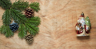 Christmas tree twig and Green Santa Claus on wooden old rustic b. Ackground. New year background Royalty Free Stock Photos