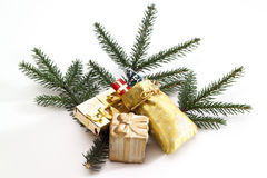 Christmas tree twig with parcel-decoration Stock Photos