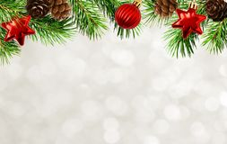 Christmas tree twigs, cones, balls and bokeh background royalty free stock image