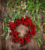 Christmas tree twigs and red berries wreath. Advent decoration Royalty Free Stock Photography
