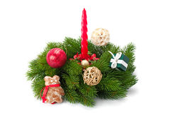 Christmas tree twigs and shiny balls ,candle and gingerbread Stock Image