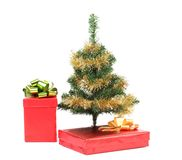 Christmas tree with two present boxes. Stock Images