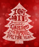 Christmas tree typography design with red falling snow bokeh design background Royalty Free Stock Photography
