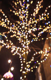 CHRISTMAS TREE UNFOCUSED IN OLD TOWN, WARSAW, POLAND. Stock Photo