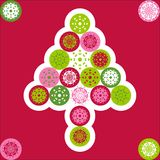 Christmas Tree Vector. Christmas greeting card cover with green, red, pink snowflakes forming Christmas tree in vector format on red Stock Photos